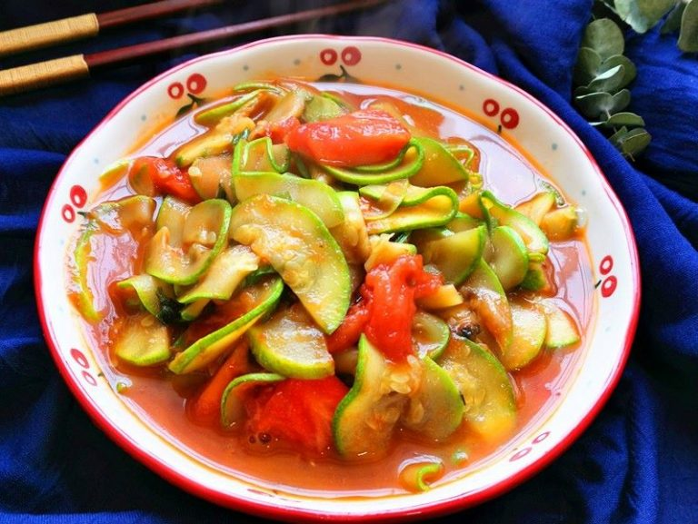 Fried zucchini with tomatoes simple vegetarian dish