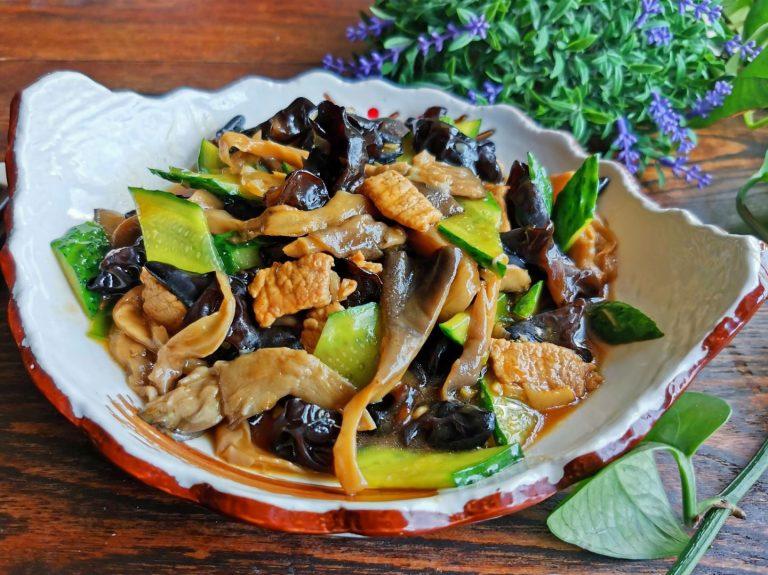 Mushrooms, black fungus and cucumber stir-fry with pork