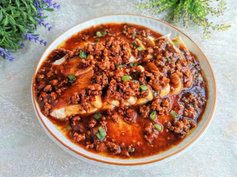 Steamed tofu and egg in minced meat sauce